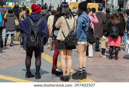 TOKYO JAPAN - MARCH 12, 2014: Girls on Shibuya crossing