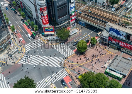 TOKYO, JAPAN - MAY 23, 2016: Aerial view of pedestrians walk at Shibuya Crossing. The scramble crosswalk is one of the largest in the world.