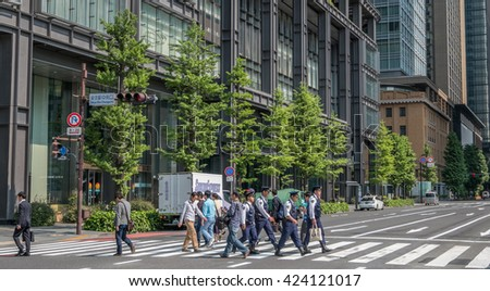 TOKYO, JAPAN - MAY 21ST, 2016. Tourists and locals sightseeing at the street of Tokyo, Japan