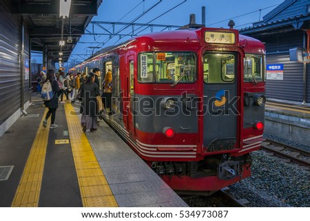 TOKYO, JAPAN - 20 NOV 2016 : Train stopped at Karuizawa Railway station at night. The railway system is one of the most important public transportation in Japan.
