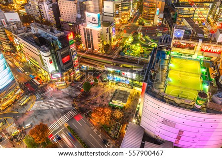 TOKYO, JAPAN - NOVEMBER 12, 2014: Aerial view of Shibuya District and Shibuya Crossing, Tokyo. The scramble crosswalk is one of the largest in the world.