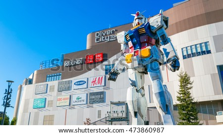 TOKYO, JAPAN - NOVEMBER 27 2015: Full-size Mobile suit Gundam RG 1/1 RX-78-2 Ver. GFT At the main entrance of Diver City Tokyo Plaza - a Shopping mall in Odaiba area