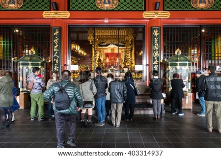 TOKYO, JAPAN - NOVEMBER 30, 2015 : Tourists visiting Sensoji Temple in Tokyo, Japan. It is the most famous Buddhist temple in Asakusa district, one of the main tourist attraction in Tokyo, Japan.