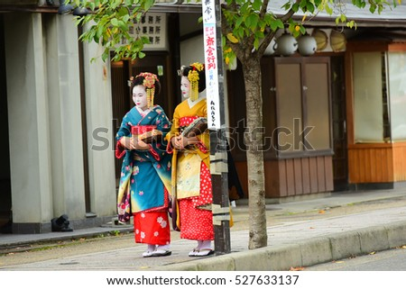 TOKYO-JAPAN - OCTOBER 07, 2016: Traditional geishas are walking on the street In Arashiyama , Kyoto, Japan on October 07, 2016