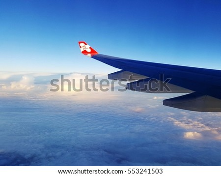 TOKYO, JAPAN - September 2: Thai AirAsia X  plane's wing with logo, the plane flying over Tokyo-Japan to Bangkok-Thailand on September 2 2016. AirAsia as Asia's Leading Low Cost Airline.