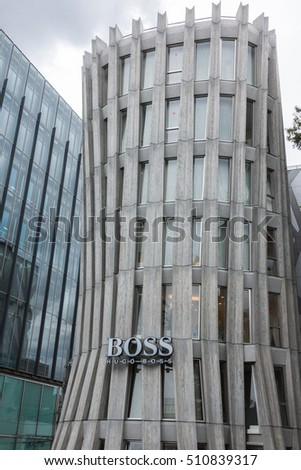 Tokyo, Japan - September 28, 2016: The iconic Hugo Boss store stands along the main road in the upscale neighborhood of Jingumae. Concrete and glass.
