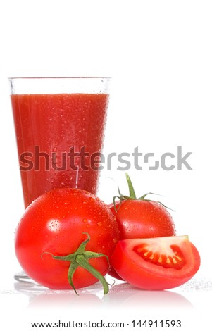 Tomato juice and ripe tomatoes on white background