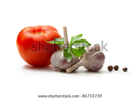 Tomato, parsley, pepper and garlic isolated on the white background