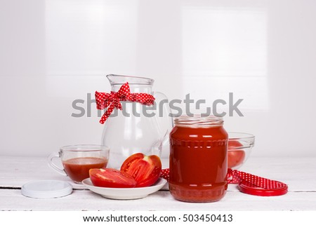 Tomatoes and tomato juice on a white kitchen