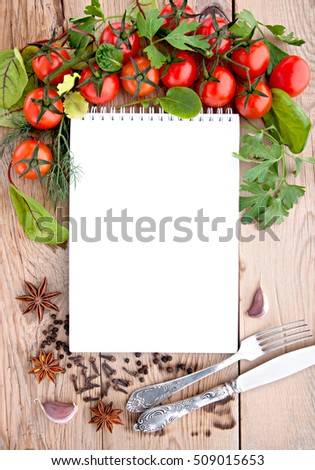 Tomatoes, garlic, parsley and spices on the wooden background with space for text. Top view.