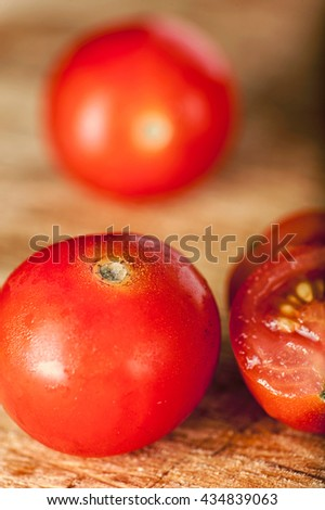 tomatoes on a textured wooden surface
