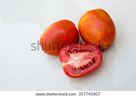 tomatoes on white marble