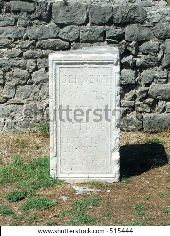 Tombstone with latin inscription in ancient roman settlement Dioclea, today Montenegro
