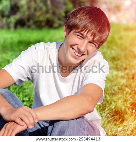 Toned Photo of Happy Teenager on the Grass