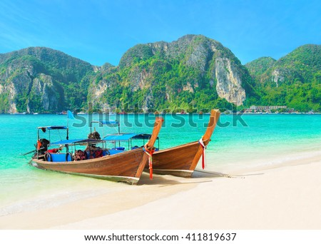 Tonsai Beach bay view with traditional longtail taxi boats parking and palm hilly seafront in Thailand, Ko Phi Phi Don island, Krabi Province, Andaman Sea