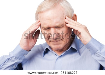 Too stressful day. Frustrated senior man in formalwear touching head with fingers and keeping eyes closed while standing against white background