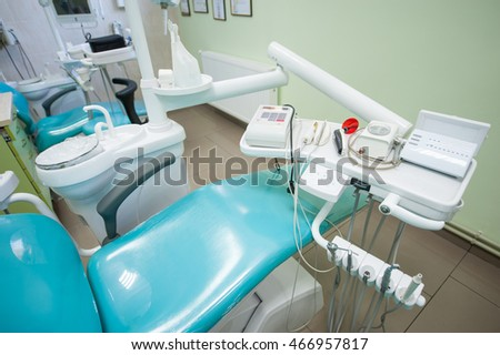 Tools for dental treatment in dentist's clinic. Dental unit and accessories to it, drills, photopolymer lamp, equipment for restorative dentistry