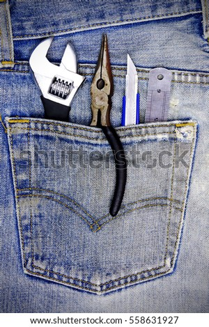 Tools on a denim workers pocket