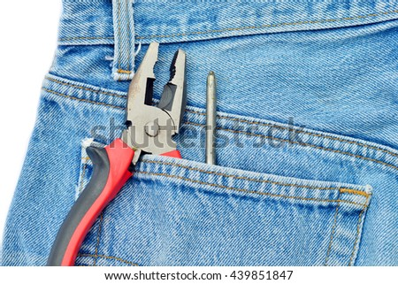 tools on a denim workers pocket on old wood Background