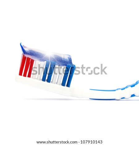 Toothbrush with toothpaste against white background