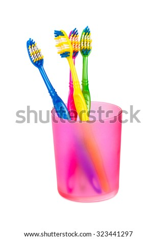 Toothbrushes in glass isolated on white background