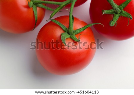 Top view bunch of fresh tomatoes isolated on white background.
