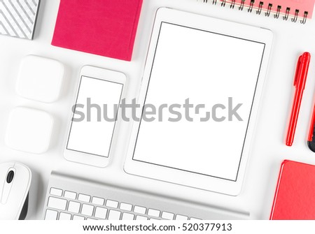 Top view: Keyboard, mouse, tablet computer and smartphone on white table background with space for text and copy space