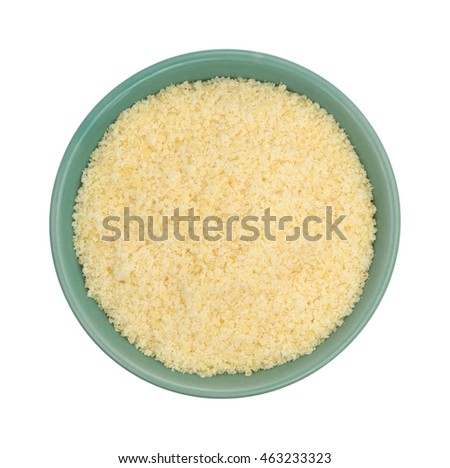 Top view of a green bowl filled with freshly grated parmesan cheese on a white background.