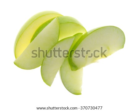 Top view of a group of green apple slices isolated on a white background.
