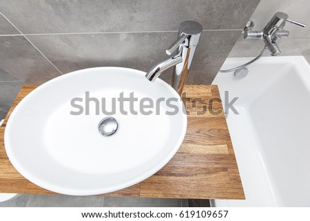 Top View Of An Oval Porcelain Sink With Bath Tub On The Right Modern Design