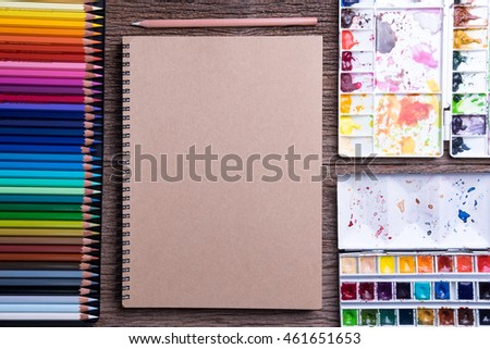 Top view of Art supplies on the wooden table