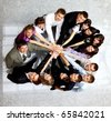 Top view of business people with their hands together in a circle - stock