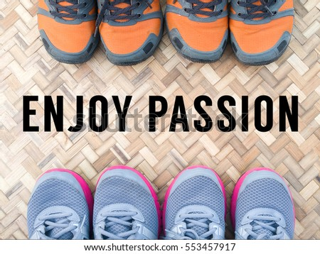 Top View of Sneaker Shoes on the bamboo mat with text enjoy passion written on background