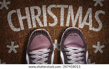 Top View of Sneakers on the grass with the text: Christmas