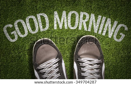 Top View of Sneakers on the grass with the text: Good Morning