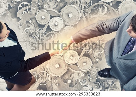 Top view of two businesswpeople shaking hands