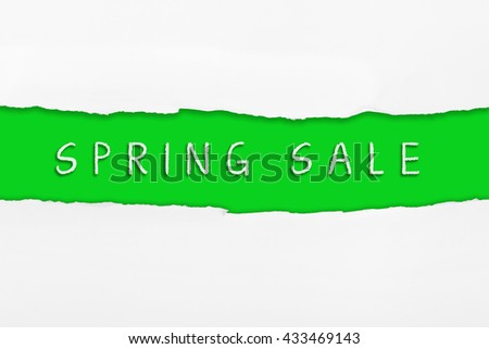 Torn paper with a SPRING SALE word on red background.