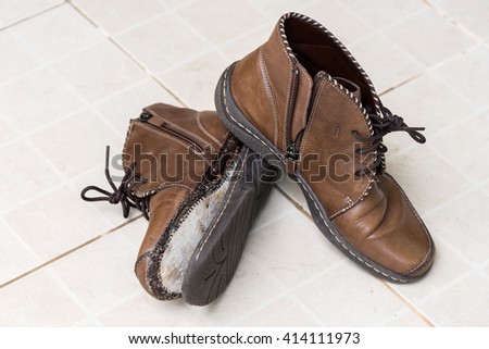 wallet on shoestring financial concept stock photo