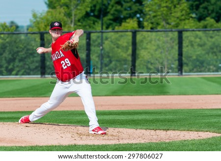 TORONTO,CANADA-JULY 12,2015: Toronto Pan American Games 2015, Baseball tournament: Jared Mortensen Canadian pitcher opens the game vs Colombia Case number - 01953074