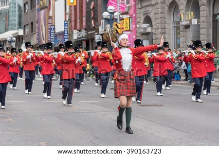 TORONTO, CANADA - March 13, 2016:  St. Patrick's Day Parade in the downtown of Toronto. Irish orchestra celebrates St. Patrick's Day.