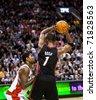 TORONTO - FEBRUARY 16: Chris Bosh No. 1 participates in an NBA basketball game at the Air Canada Centre on February 16, 2011 in Toronto, Canada.  The Miami Heat beat the Toronto Raptors 103-95. - stock photo