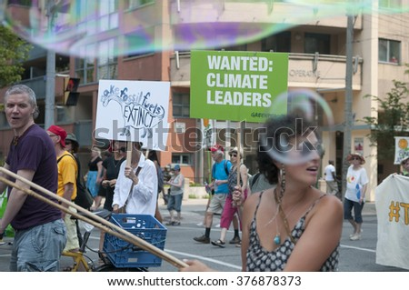 "TORONTO - JULY 5 : Participants walking among bubbles saying "" wanted climate leaders""   during the Jobs,Justice and Climate rally on July  5, 2015 in Toronto, Canada."