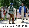 TORONTO – JUNE 19: Actors and actresses at reenactment of Revolutionary War between refugees and Loyalists at  Black Creek -  on June 19, 2011 in Black Creek Village, Toronto - stock photo