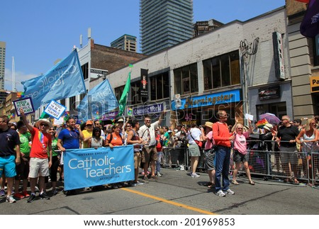 TORONTO - JUNE 29:Teachers at World Pride Parade in June 29, 2014 in Toronto, Canada.
