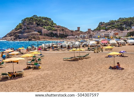 Tossa de Mar, Costa Brava, Catalonia, Spain - September 6, 2016: Gran Beach in Tossa de Mar and the view of the city-fortress of Villa Vella.