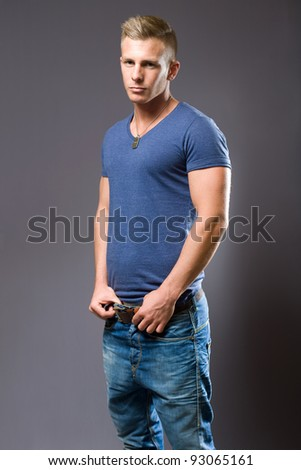 Tough guy, portrait of muscular fit young man.
