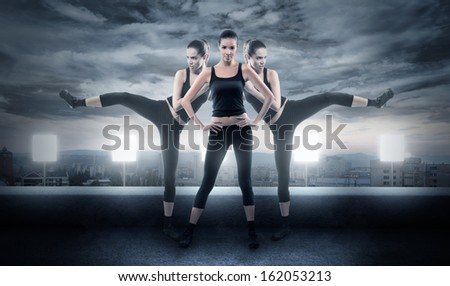 Tough woman in fighting poses in urban environment