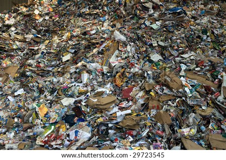 TOULOUSE, FRANCE - CIRCA 2008: Newspapers and plastic bottles lie in a heap at an undisclosed recycling facility circa 2008 in Toulouse. The paper and plastic will be sorted and baled.