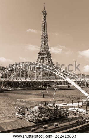 Tour Eiffel (Eiffel Tower) located on Champ de Mars, named after engineer Gustave Eiffel. Eiffel Tower is tallest structure in Paris and most visited monument in world. France. Vintage sepia toned.