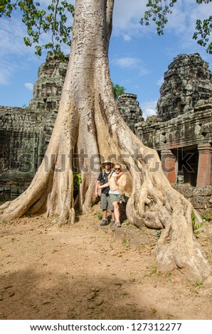 Tourist couple and tree in Banteay Kdei Temple - Angkor, Cambodia